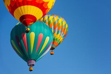 Hot air balloons against blue sky.