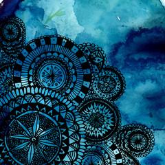 Blue watercolor brush strokes with black hand drawn mandalas -