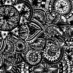 Black and white ornate hand drawn doodles with paisleys and