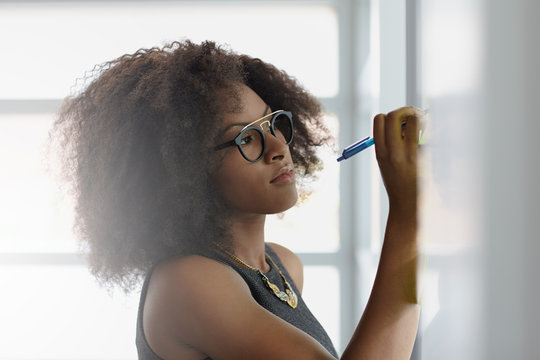Portrait of a smiling business woman with an afro in bright