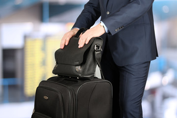 young businessman  in  a modern  stylish suit with  luggage in