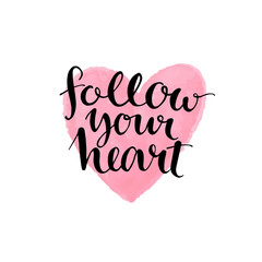 Brush lettering quote follow your heart at pink watercolor