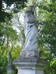 Religious stone statue at a Catholic cemetery.