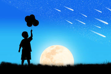 Silhouette of little boy hand hold bubble look at meteor shower