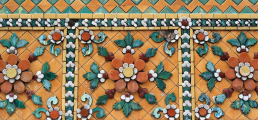 old ceramic tiles patterns at Temple of the Emerald Buddha or Wat  Pho at Bangkok, Thailand