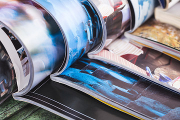 stack of open colorful magazines. information
