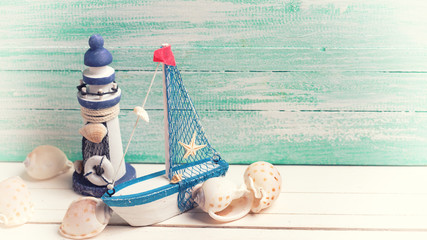 Decorative lighthouse, sailing boat and marine items