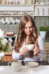 Happy woman enjoying her coffee