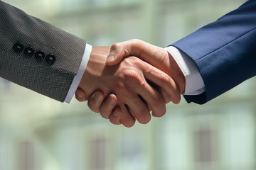 Men in business suits shaking hands