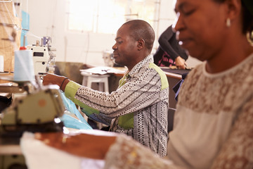 People sewing at a community project workshop, South Africa