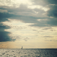 Sailing ship profile. Toned image. Rainy clouds.