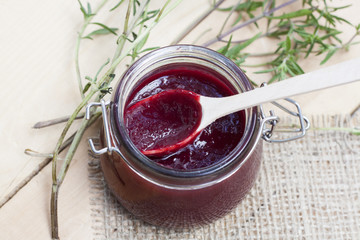 Home made organic cherry jam confiture on a wooden table