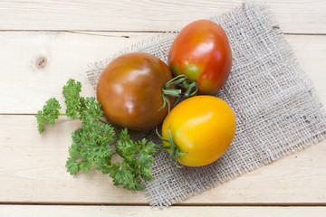 Assorted tomatoes: orange, pink, black tomatoes with parsle
