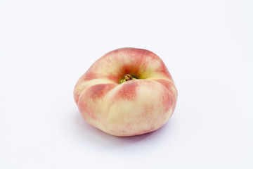 Ripe flat Chinese peaches on the white isolatd background