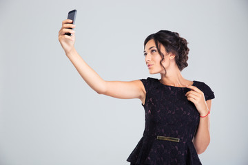 Woman in black dress making selfie photo