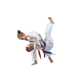 Boy and girl doing judo throws