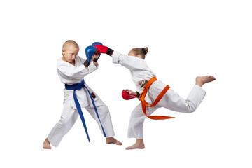 Boy and girl trains the blow gyaku-tsuki in jumping
