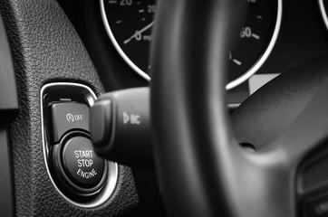 Engine start stop button in a modern passenger car.