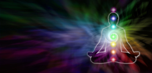 Chakra Meditation Website Header - Wide dark banner with a rainbow colored spiral formation and a male silhouette seated in lotus position on the right and plenty of copy space