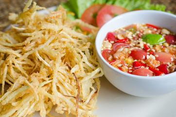 Deep fried papaya salad with spicy sauce