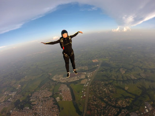 Skydiver woman standing in the sky