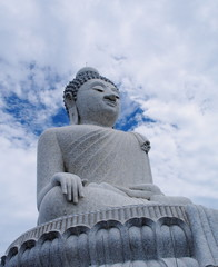 Massive white marble Buddha statue and tourist destination on top of hill in Phuket, Thailand.