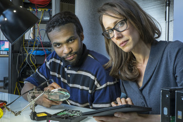 Portrait of male and female information technology workers