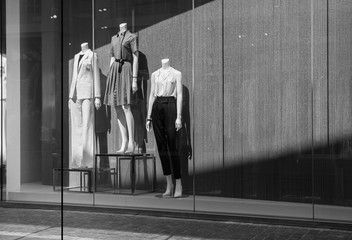 Female mannequins in a shop window. Black and white photo