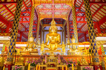 golden buddha statue in suan dok temple