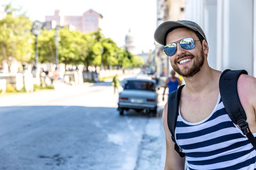 Tourist posing for pictures in Havana, Cuba