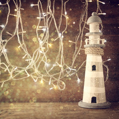 nautical lifestyle concept. old vintage lighthouse on wooden table