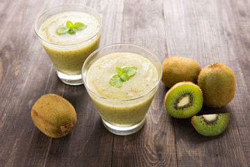 kiwi smoothie with fresh fruits on wooden table