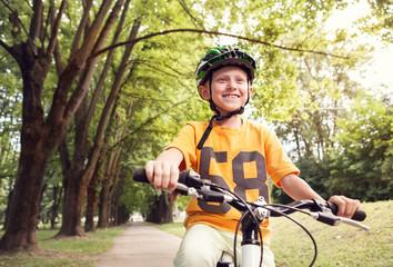 Boy ride bicykle