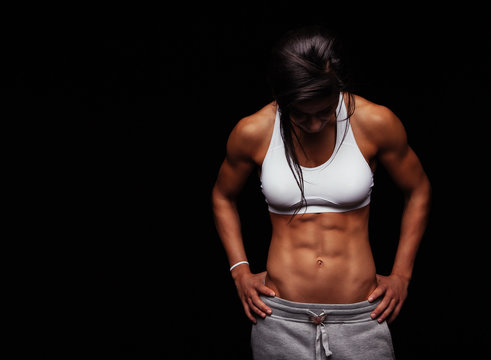 Female athlete with muscular abs