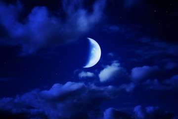 night beautiful blue sky with cumulus clouds, moon and stars