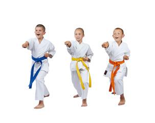 Children in karategi are beating kick gyaku-tsuki