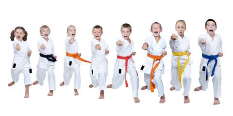 In karategi eight athletes are beating punch gyaku-tsuki