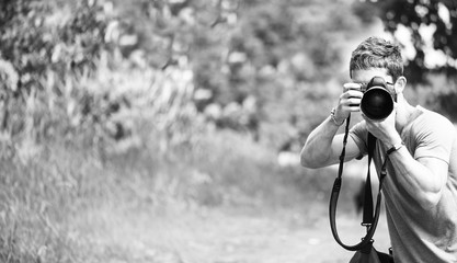 Fashion photographer photographing  nature
