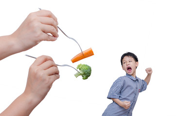 Little Asian boy run away from eating vegetables over white