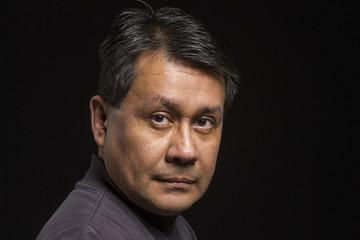 Studio portrait of a serious Hispanic male