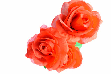 Artificial red roses isolated on white background
