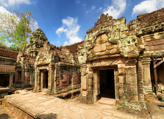 Ancient mossy buildings with carving of Preah Khan temple
