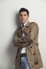 young man in trench rain coat autumn styling