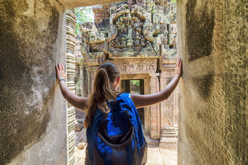 Tourist coming to the ancient temple in Angkor, Cambodia
