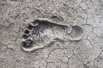 A footprint of human on dry crack soil cause drought