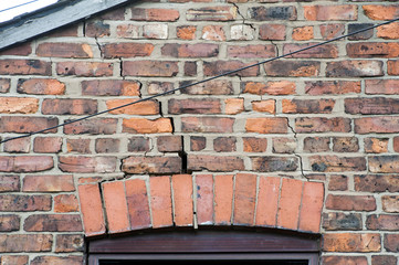 step cracking damage to brickwork in a wall above a window as a result of subsidence