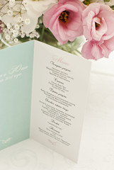 Menu card with beautiful flowers on table in wedding day