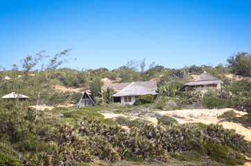 Houses with view of the Indian Ocean in the dunes of Praia do Tofo in Inhambane, Mozambique