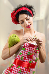 Pinup lady holding needles and ball of thread