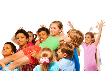 Croup of kids carry girl on hands
